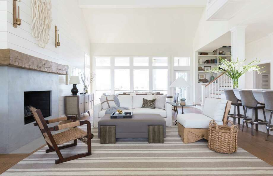 One Houston couple bought a new bayside vacation home in Galveston and upated it in every room. Their style is casual but sophisticated. On the main floor they used a lot of shiplap and white paint. Photo: Julie Soefer / Julie Soefer Photography