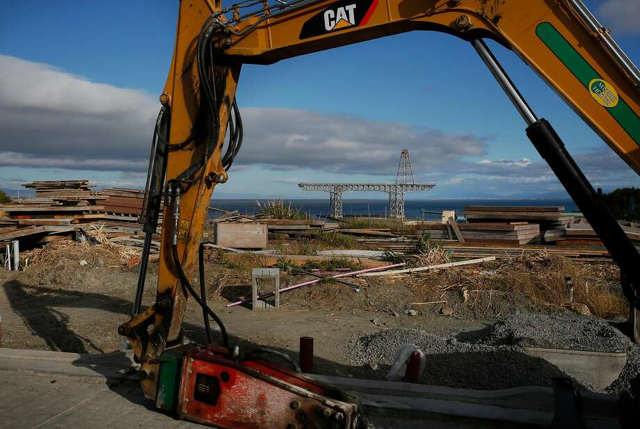 An excavator is shown at the San Francisco Shipyard development in 2016.        There are now concerns that, years earlier, cleanup and testing of        contaminated soil at the site was botched. Photo: Leah Millis, The Chronicle