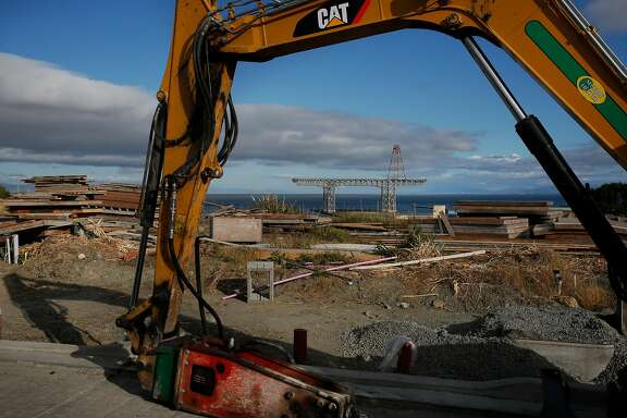 An excavator is shown at the San Francisco Shipyard development in 2016.        There are now concerns that, years earlier, cleanup and testing of        contaminated soil at the site was botched.