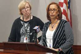 (Left) Sen. Cathy Osten, D-Baltic, and (right) Rep. Toni Walker, D-New Haven, introduce the Democrat's proposed fiscal year 2019 state budget in the Capitol in Hartford, Conn. on Friday, April 20, 2018.