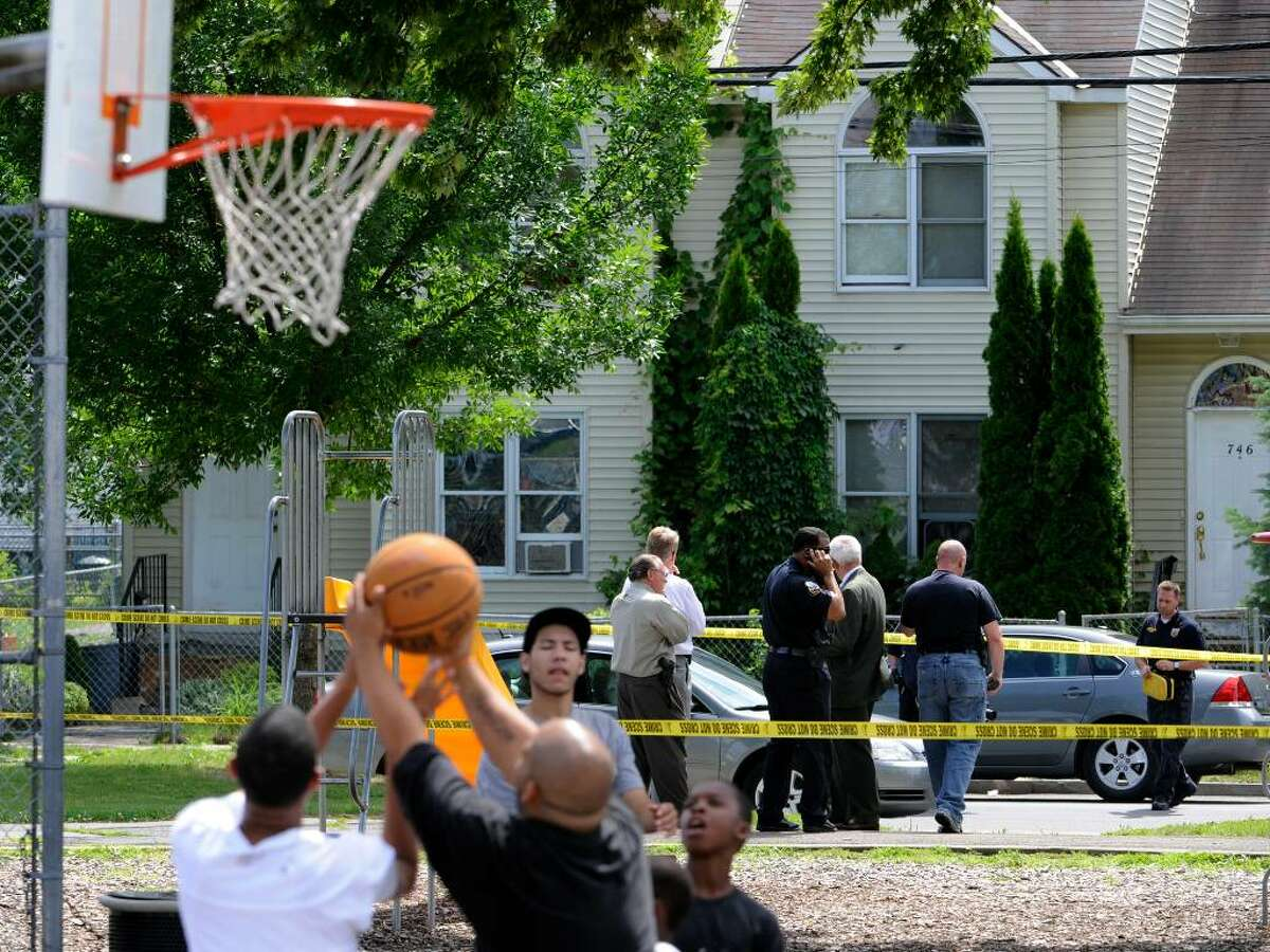 Just beyond the crime scene tape, a basketball game is underway at Jerry Burrell Park in Schenectady where an 11-year-old boy collapsed in the park after he was shot in the head Wednesday. A 20-year-old man was shot nearby and police also dealt with a stabbing during a chaotic afternoon in Schenectady. (Skip Dickstein/Times Union)