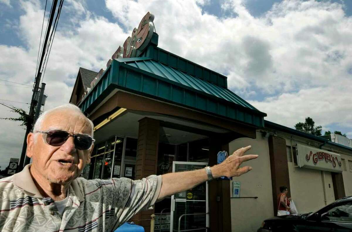 Former Rotterdam policeman Ernest Townsend , now 84 years old, who was on the scene at Gabriel's market when the tornado of 1960 hit points to where the sky turned a sinister orange 60 years ago in Rotterdam.( Michael P. Farrell / Times Union )