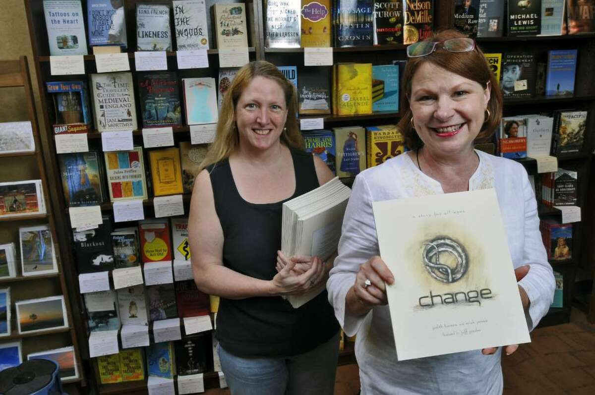 Susan Novotny, owner of The Book House of Stuyvesant Plaza, holds a copy of