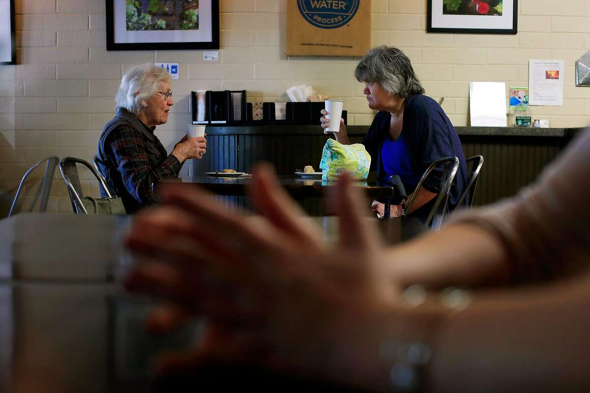 Mother and daughter Nadine Heppell (l to r) and Colleen Heppell talk during a visit to Blue Beagle Coffee on Tuesday, April 17, 2018, in Santa Rosa, Calif.