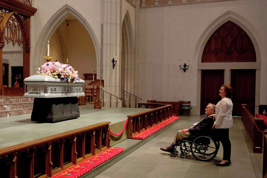 "Former President George H. W. Bush looks at the casket of his wife former first lady Barbara Bush with his daughter Dorothy ""Doro"" Bush Koch at St. Martin's Episcopal Church Friday, April 20, 2018, in Houston. Barbara Bush died on April 17, at the age of 92. (Mark Burns/Office of George H.W. Bush via AP) Photo: Mark Burns, Associated Press / Office of George H.W. Bush"