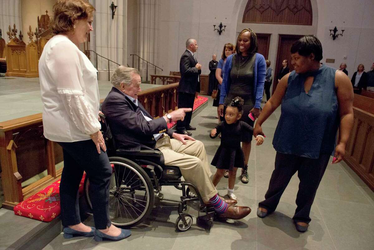 Former President George H. W. Bush greets the mourners with his daughter Dorothy