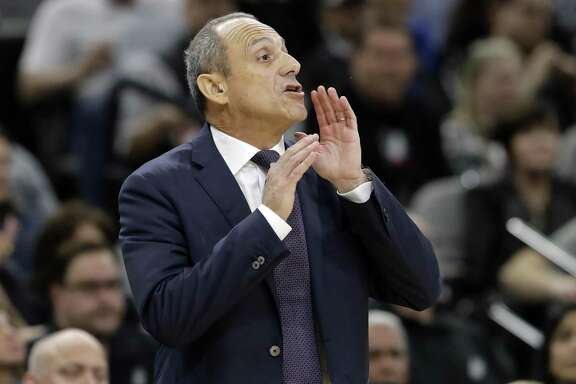 San Antonio Spurs assistant coach Ettore Messina shouts to the team during the first half of Game 3 of a first-round NBA basketball playoff series against the Golden State Warriors in San Antonio, Thursday, April 19, 2018. (AP Photo/Eric Gay)