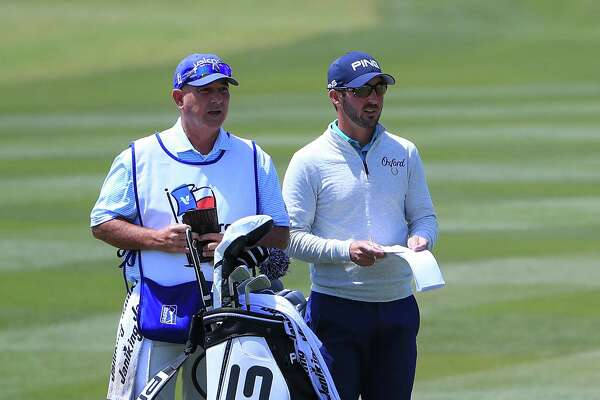 SAN ANTONIO, TX - APRIL 19:  Andrew Landry talks with his caddie before playing his second shot on the 18th hole during the first round of the Valero Texas Open at TPC San Antonio AT&T Oaks Course on April 19, 2018 in San Antonio, Texas.