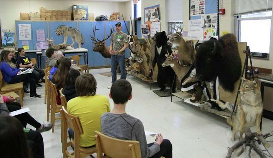 Kevin Klee, an Ubly resident and owner of Nature's Finest Taxidermy, talks to Bad Axe Middle School students during Friday's Career Day. (Mike Gallagher/Huron Daily Tribune)
