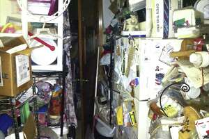 Clutter fills a home in Danbury where officials recently assisted a resident suffering from a hoarding disorder. The refrigerator is barely visible in the right side of the photograph.