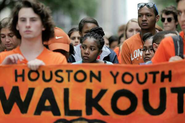 High school students wait in silence before walking after the presentation during the Houston Youth Walkout, a march to coincide with the anniversary of Columbine High School shooting on Friday, April 20, 2018, in Houston. The students walked from Carnagie Vanguard High School in Montrose to Houston City Hall.