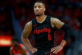 NEW ORLEANS, LA - APRIL 19:  Damian Lillard #0 of the Portland Trail Blaers stands on the court as his team trails the New Orleans Pelicans during Game 3 of the Western Conference playoffs against the Portland Trail Blazers at the Smoothie King Center on April 19, 2018 in New Orleans, Louisiana. NOTE TO USER: User expressly acknowledges and agrees that, by downloading and or using this photograph, User is consenting to the terms and conditions of the Getty Images License Agreement.  (Photo by Sean Gardner/Getty Images)