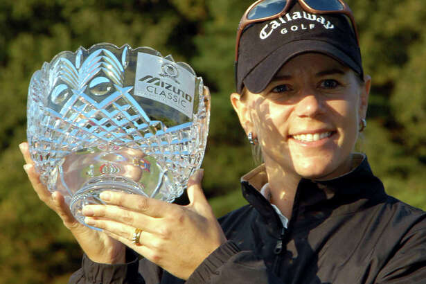 Annika Sorenstam of Sweden holds a victory trophy during an awarding ceremony of the Mizuno Classic at Seta Golf Course in Otsu, western Japan Sunday, Nov. 10, 2002. Sorenstam became the first LPGA player in 34 years to win 10 times in one season, successfully defending her title Sunday in the Mizuno Classic. (AP Photo/Katsumi Kasahara)