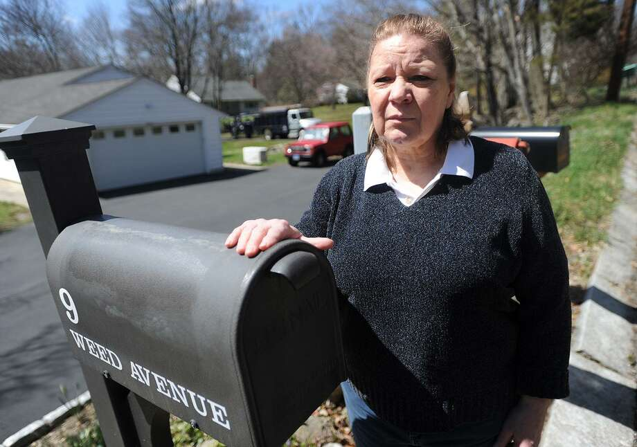 Rose Carroll stands by her mailbox at 9 Weed Avenue in Norwalk, Conn. on Friday, April 20, 2018 where she discovered her patriotic mailbox cover missing. The mailbox cover was a memory of her deceased husband, a Vietnam veteran. Photo: Brian A. Pounds / Hearst Connecticut Media / Connecticut Post