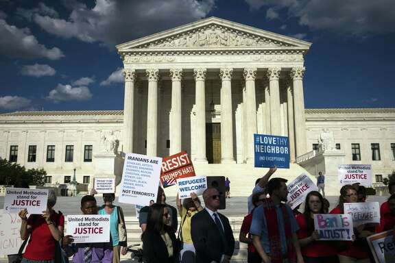 Demonstrators against President Donald Trump's travel ban outside the Supreme Court on June 26. The Supreme Court will hear arguments in a challenge to Trumps executive order that restricted travel from eight nations, six of them predominantly Muslim.