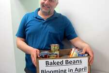 Derby City/Town Clerk Marc Garofalo, a former four-term Derby mayor, stands near the collection box for baked beans. The city delivered 120 cans to the St. Vincent DePaul Food Bank, 237 Roosevelt Drive. This month they are collecting cans of tuna fish and jars of mayonnaise which can be dropped off at his office.
