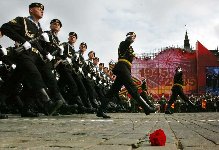 Russian marines march along the Red Square during a 2005 parade in Moscow. With Putin beginning a new six-year term, there is no guarantee his military adventures will end.