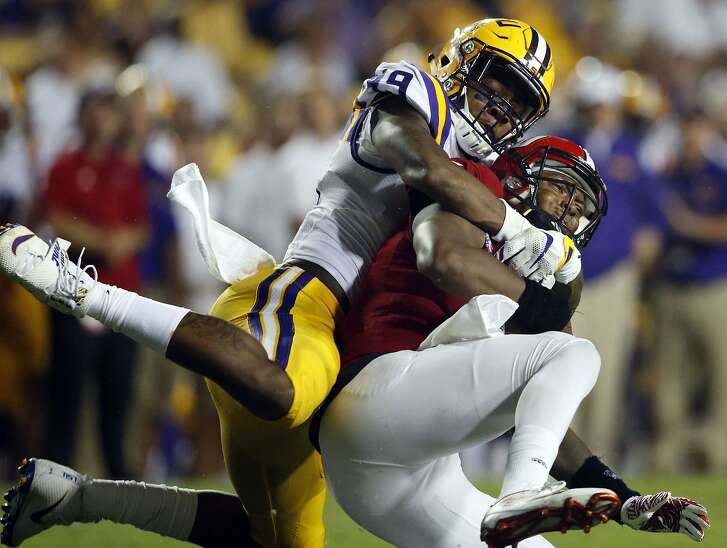 FILE - In this Sept. 10, 2016, file photo, Jacksonville State quarterback Eli Jenkins is sacked by LSU defensive end Arden Key (49) in the second half of an NCAA college football game in Baton Rouge, La. Key has been cleared to come back from shoulder surgery and play Saturday, Sept. 16, 2017 at Mississippi State. (AP Photo/Gerald Herbert, File)
