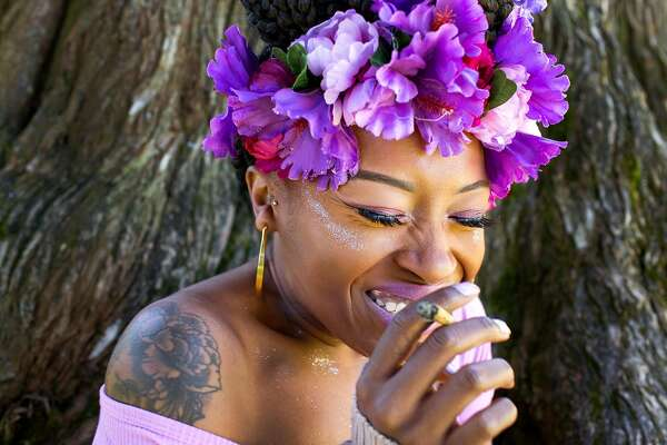 Imani Triplett poses for a portrait at the Hippie Hill 4/20 celebration in Golden Gate Park on Friday, April 20, 2018. San Francisco Calif. This is the first year when  recreational marijuana use is legal in California.
