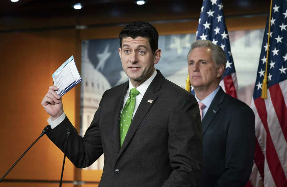 With his possible successor, Kevin McCarthy, standing behind him, House Speaker Paul Ryan talks to reporters about income tax filing last week. Ryan has decided not to run for re-election, and a reader says it is partly because he lost the trust of Wisconsin voters. Photo: J. Scott Applewhite /Associated Press / Copyright 2018 The Associated Press. All rights reserved.