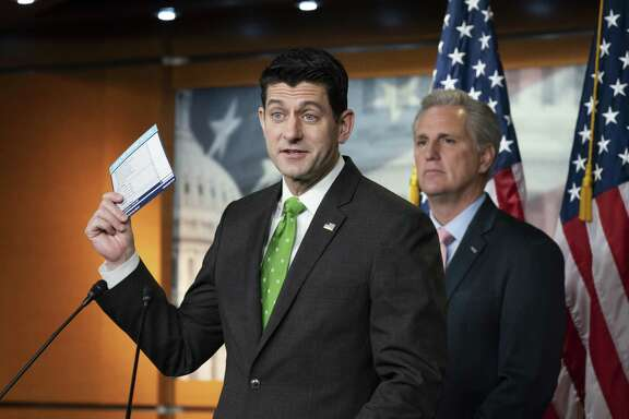 With his possible successor, Kevin McCarthy, standing behind him, House Speaker Paul Ryan talks to reporters about income tax filing last week. Ryan has decided not to run for re-election, and a reader says it is partly because he lost the trust of Wisconsin voters.