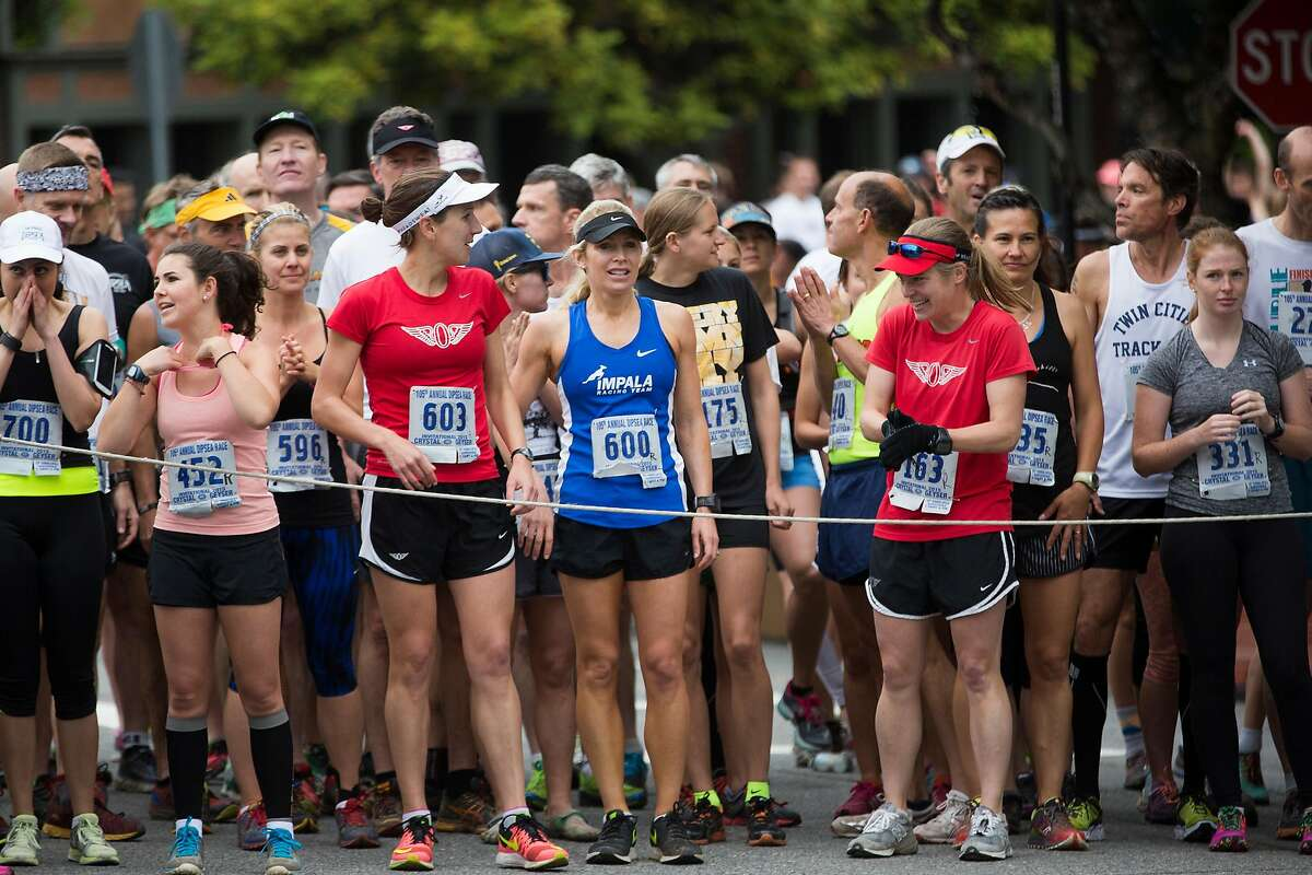 A group of runners stand behind a queue line during the 105th annual Dipsea Race in Mill Valley, Calif. on Sunday, June 14, 2015.
