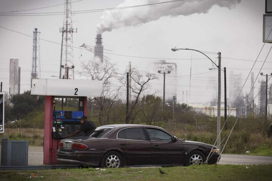 Steam comes from refineries near a gas station in Texas City, Texas in 2014. Pollution from such facilities add to a growing health crisis, but another main source comes from our vehicles, which means that pollution from these kills more people than traffic accidents. Photo: MICHAEL STRAVATO /New York Times / NYTNS