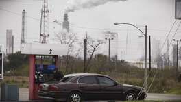 Steam comes from refineries near a gas station in Texas City, Texas in 2014. Pollution from such facilities add to a growing health crisis, but another main source comes from our vehicles, which means that pollution from these kills more people than traffic accidents.