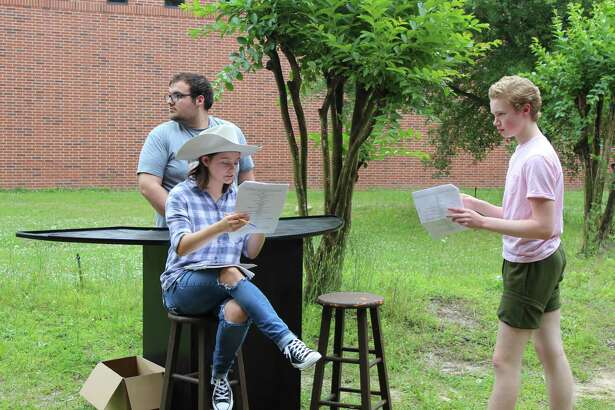 The Woodlands High School theater students rehearse lines for the upcoming The Twilight Zone production on May 5. The seniors, pictured, will perform the classic episode Showdown with Rance McGrew.