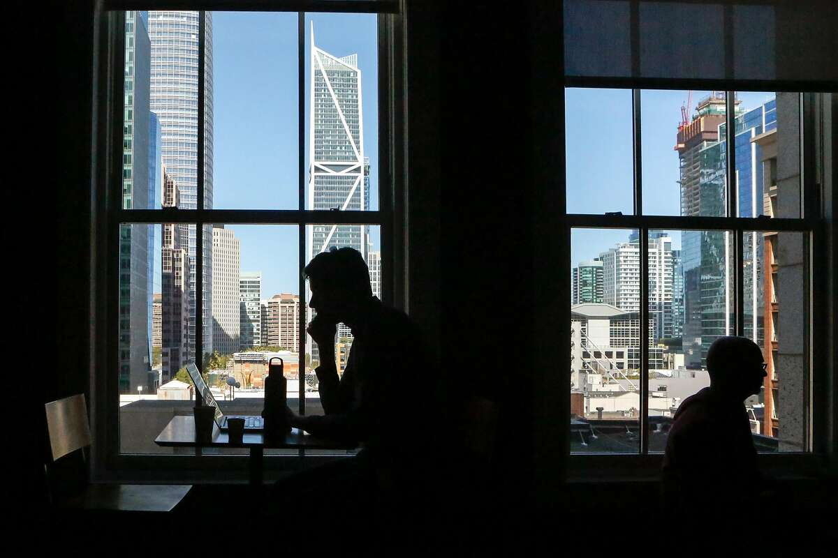 Employees work at various spaces around the building at the Yelp headquarters on Thursday, April 18, 2018 in San Francisco, California.