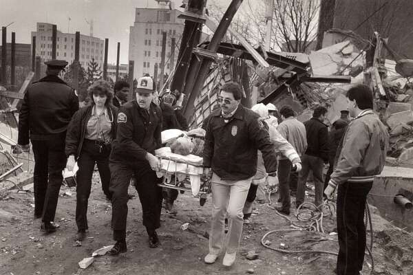File photograph of the L'Ambiance Plaze collapse, in Bridgeport, Conn. The collapse, on April 23rd, 1987, killed 28 construction workers. On Monday, there will be a ceremony marking the 31st anniversary of the collapse of L'Ambiance Plaza.