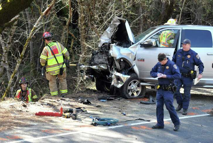 Nevada County firefighters, at left, work on retrieving the body of a driver and vehicle down an embankment involved in a fatal head-on collision on Highway 49 at Rush Creek Way, just north of Nevada City, Calif., March 23. Zero traffic deaths in the U.S. is attainable.