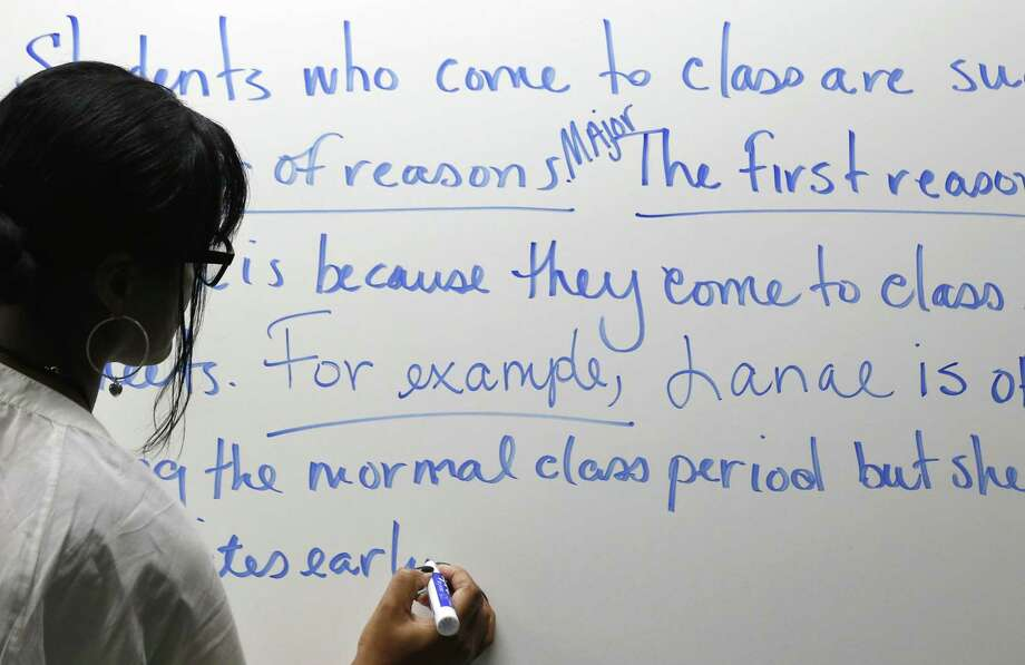 "A professor teaches remedial English at Baltimore City Community College. In Texas, ""corequisites"" courses will replace such classes. Students will take these these classes while enrolled in college courses. Photo: Patrick Semansky / Associated Press / AP"