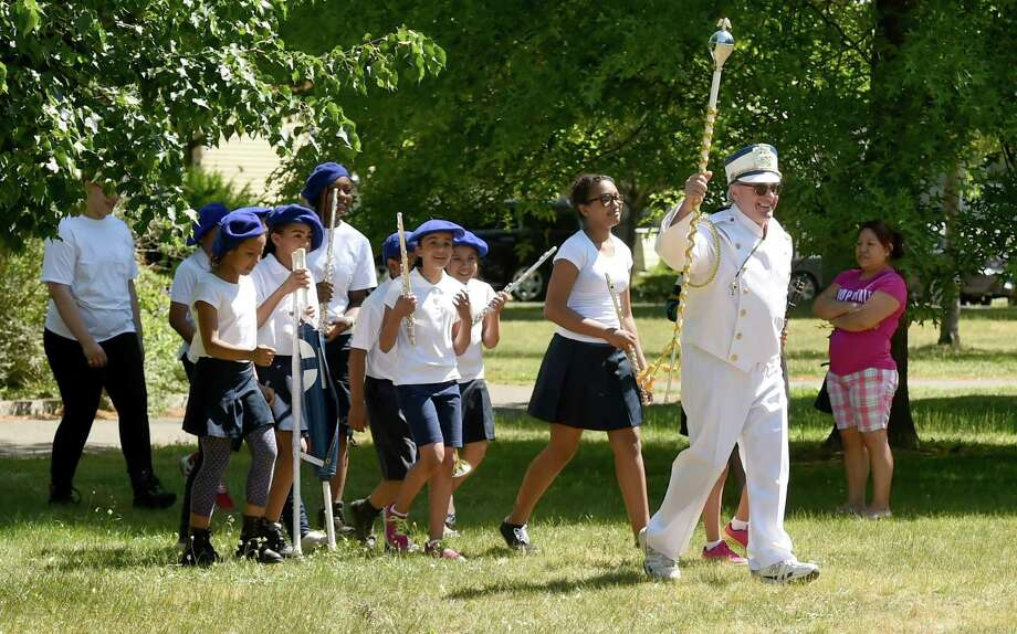 (Peter Hvizdak - New Haven Register) Joseph Collette, the Clinton Avenue School band director, leads the band to the start of the parade route during the 7th annual Fair Haven Community Parade in New Haven  Friday, May 29, 2015. The parade went from Chatham Square to Pine Street, Grand Ave. and back to Clinton Ave. and Pine Street.  The parade was hosted by the Mary Wade Home in New Haven. Photo: ©2015 Peter Hvizdak / ©2015 Peter Hvizdak