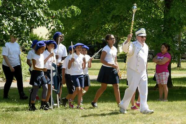 (Peter Hvizdak - New Haven Register) Joseph Collette, the Clinton Avenue School band director, leads the band to the start of the parade route during the 7th annual Fair Haven Community Parade in New Haven Friday, May 29, 2015. The parade went from Chatham Square to Pine Street, Grand Ave. and back to Clinton Ave. and Pine Street. The parade was hosted by the Mary Wade Home in New Haven.