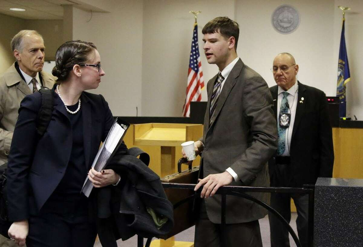 Nathan Carman, second from right, a Vermont man accused by family members of killing his millionaire grandfather and possibly his mother, who lived in Middletown, in an attempt to collect inheritance money, prepares to leave district court April 3 in Concord, N.H., after a hearing to request more information from him.