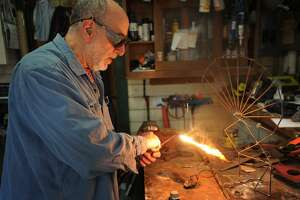 Artist/educator Philip Levine welds one in a new series of steel sculptures in his studio in Stratford, Conn. on Wednesday, April 18, 2018. Levine was one of over two hundred Bridgeport teachers jailed during the Bridgeport teacher strike in 1978.