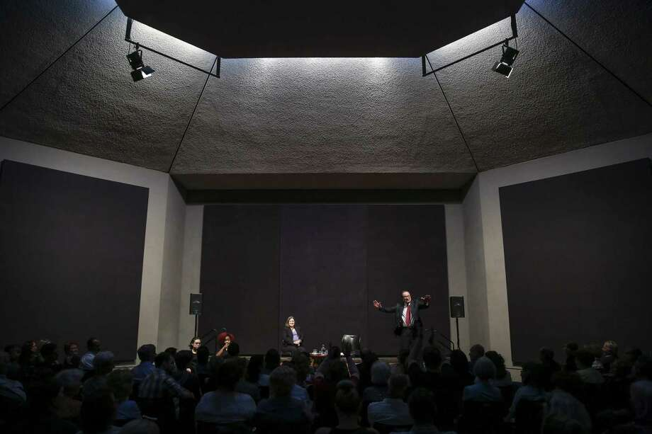 Former NASA Houston engineer Jerry Woodfill, right, recounts his memories of the Apollo 13 space mission before an audience at Rothko Chapel. Photo: Michael Ciaglo, Houston Chronicle / Houston Chronicle / Michael Ciaglo