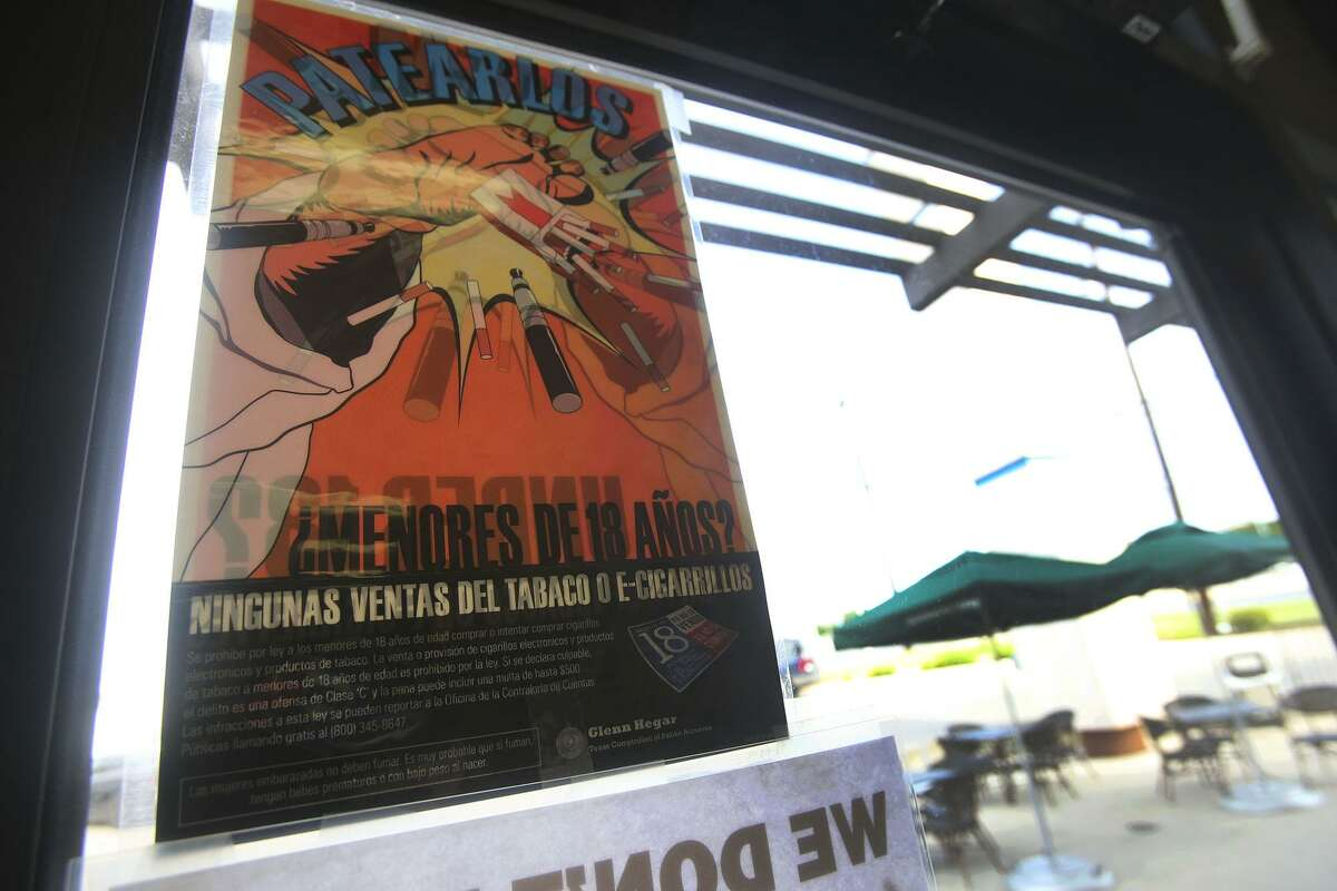 A sign at Smoke to Live reminds customers in Spanish of the legal age to buy tobacco products. In San Antonio, that age increases to 21 on Oct. 1. Merchants who violate the city ordinance could face a fine of up to $500, but those younger than 21 caught buying or using tobacco won't be penalized.