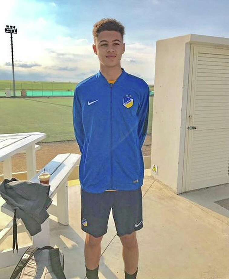 Jeremy Cooke, a 14-year-old Norwalk resident, wears APOEL FC gear he received while training with the club's youth academy earlier this year. Photo: Contributed Photo