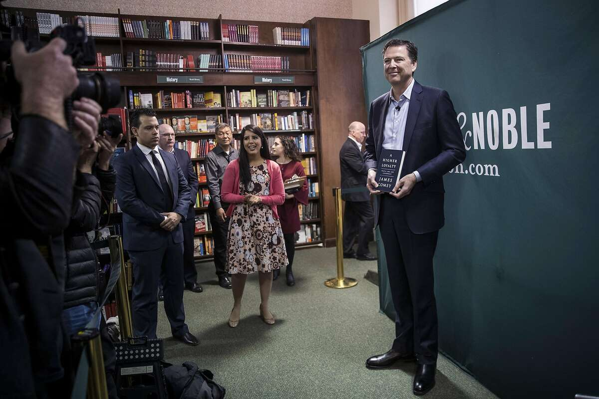 """NEW YORK, NY - APRIL 18: Former FBI Director James Comey poses for photographs as he arrives to speak about his new book """"A Higher Loyalty: Truth, Lies, and Leadership"""" at Barnes & Noble bookstore, April 18, 2018 in New York City. The book, which went on sale yesterday, focuses on leadership principles and details his interactions with President Donald Trump. Comey served as FBI Director from September 2013 until May 2017, when he was fired by the president. Comey previously served as U.S. Deputy Attorney General and U.S. Attorney for the Southern District of New York. (Photo by Drew Angerer/Getty Images)"""