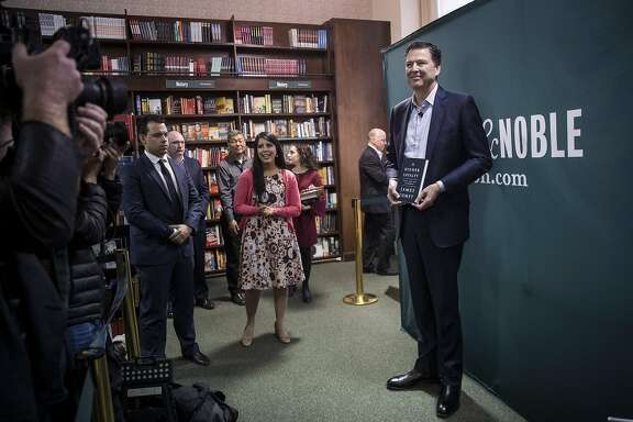 "NEW YORK, NY - APRIL 18: Former FBI Director James Comey poses for photographs as he arrives to speak about his new book ""A Higher Loyalty: Truth, Lies, and Leadership"" at Barnes & Noble bookstore, April 18, 2018 in New York City. The book, which went on sale yesterday, focuses on leadership principles and details his interactions with President Donald Trump. Comey served as FBI Director from September 2013 until May 2017, when he was fired by the president. Comey previously served as U.S. Deputy Attorney General and U.S. Attorney for the Southern District of New York. (Photo by Drew Angerer/Getty Images)"