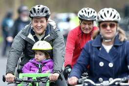 Peter Hadler (left) of New Haven rides with his daughter, Isabelle, 2, in the 8-mile family ride during the 9th Annual Rock to Rock Earth Day Ride at Common Ground High School in New Haven on 4/22/2017.