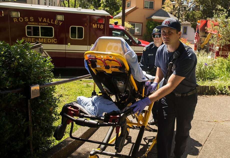 Emergency medical officers from the Marin County Fire Department respond to a call in Fairfax. Photo: Photos By Jessica Christian / The Chronicle