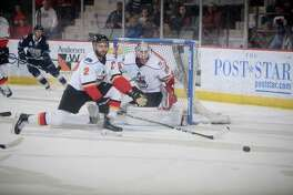 Adirondack Thunder captain Mike Bergin (2) and goaltender Mackenzie Blackwood defend the goal in an ECHL playoff game against the Worcester Railers. (Andy Camp/Adirondack Thunder)