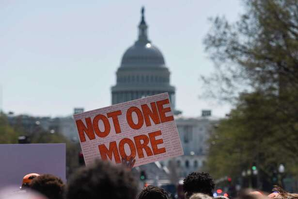 Hundreds of students marched down Pennsylvania Avenue on Friday as part of a school walkout protesting gun violence. It came on the 19th anniversary of the Columbine massacre.