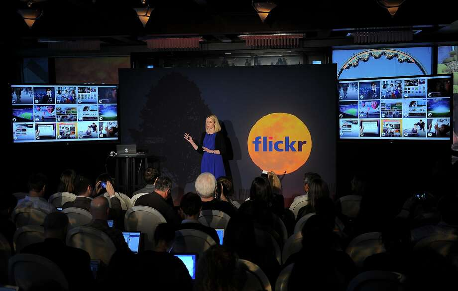 As Yahoo CEO, Marissa Mayer, seen here at a 2013 event, sought to upgrade Flickr. But now Verizon, which bought Yahoo last year, is selling Flickr to SmugMug. Photo: Emmanuel Dunand / AFP / Getty Images