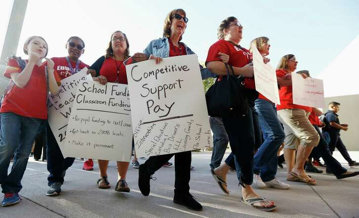 """Teachers at Tuscano Elementary School in Phoenix stage a """"walk-in"""" for higher pay and school funding."""