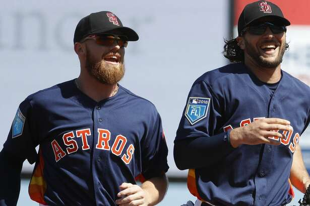 Houston Astros outfielder Jake Marisnick (6) laughs with Derek Fisher (21) after diving to catch Washington Nationals Matt Adams' flyout in the first inning of the Houston Astros spring training game against the Nationals at The Fitteam Ballpark of the Palm Beaches, Friday, Feb. 23, 2018, in West Palm Beach.   ( Karen Warren / Houston Chronicle )