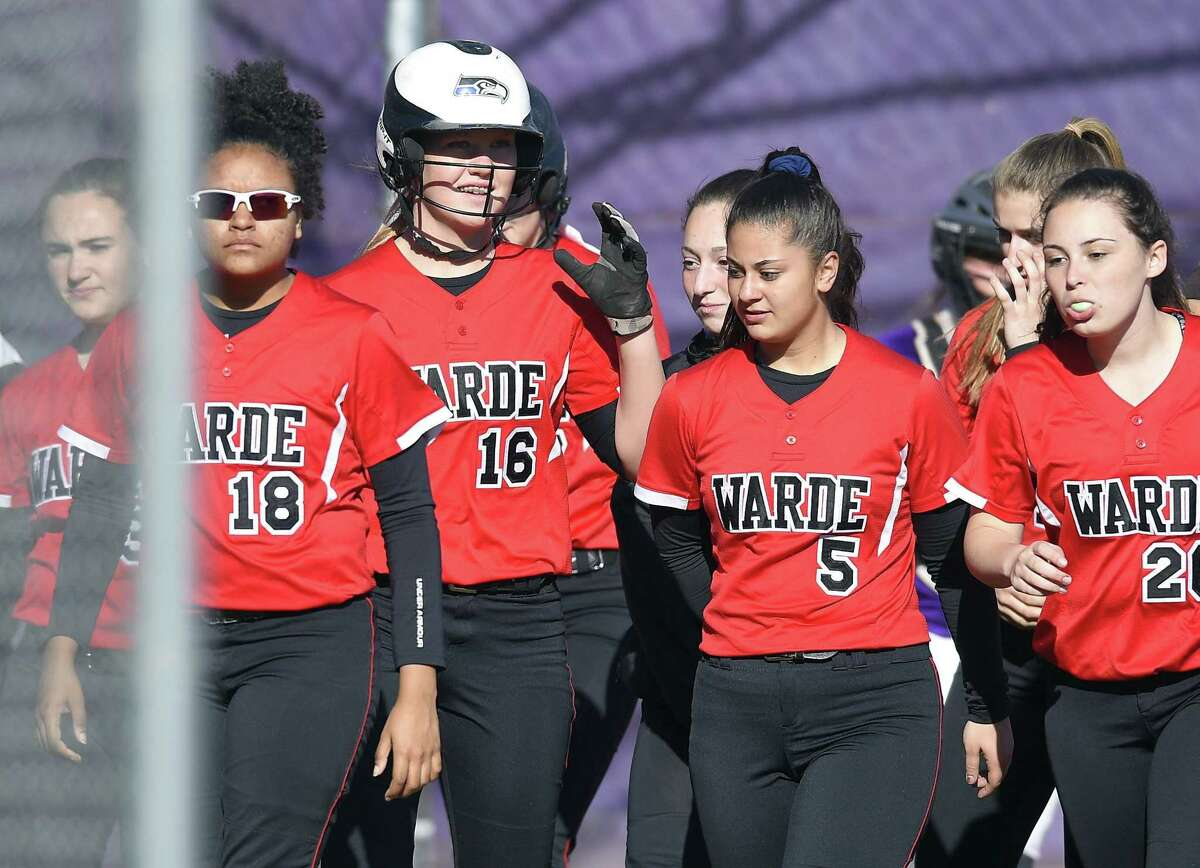 Fairfield Warde Olivia Vadas (16) celebrates with teammates following a sixth inning homerun against Westhill in a FCIAC girls softball game at Westhill High School in Stamford, Conn. on April 20, 2018. Fairfield Warde defeated Westhill 9-4.